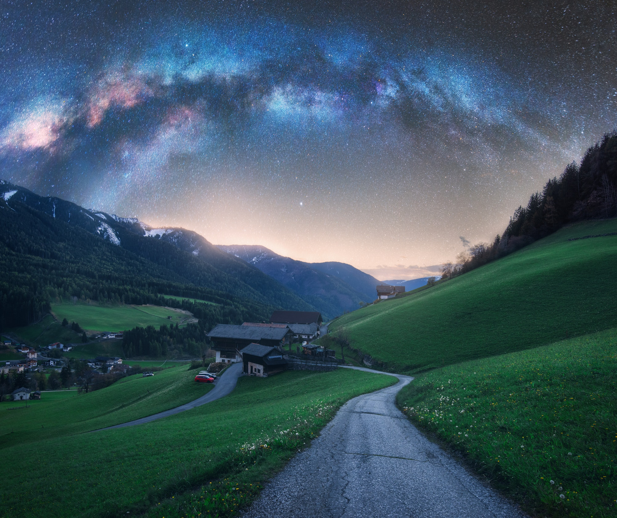 Arched Milky Way over the rural mountain road in summer in Italy